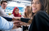 multiethnic Group of young business people celebrating success