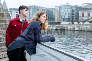young woman and man hanging out by the river in Berlin Germany