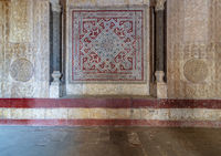 Stone wall decorated with colorful engraved floral and geometric patterns at the entrance of Sultan Hassan mosque, Cairo, Egypt