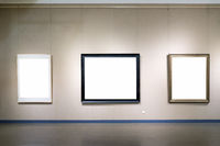 blank picture frames on wall