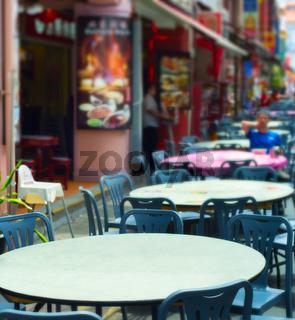 Street restaurant tables. Singapore Chinatown