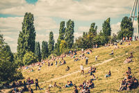 Berlin City summer concept - blurry image of people in crowded Park (Mauerpark) on a sunny summer  day