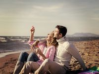 young couple enjoying time together at beach