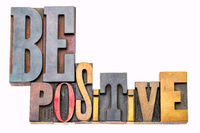 Be positive word abstract in wood type
