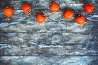 Top view of ripe persimmons on wooden rustic table