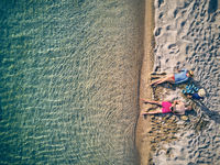 Beautiful beach with family drone shot