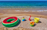 Beach with inflatable ring and toys