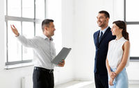 realtor with folder showing customers new office