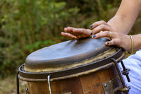 Woman hands playing the drum