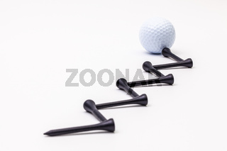 White golf balls and wooden tees