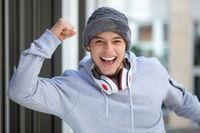 Successful happy young latin man runner jogger sport sports cold winter joy pleasure