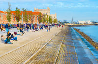 People at  waterfront. Lisbon, Portugal