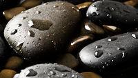 Black wet pebbles background wallpaper