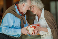 Senior couple with gift