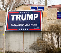 Signs Supporting Trump and the Slogan Make America Great Again
