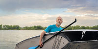 senior man with stand up paddleboard