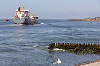 Dutch waterside Vlissingen with cargo ship sailing close to coast