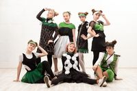 Girls in fashion costumes isolated group portrait