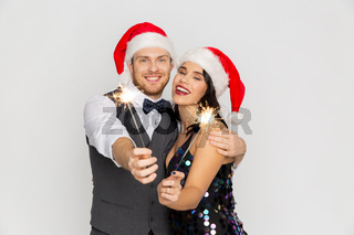 happy couple in santa hats at christmas party