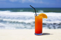 Cocktail glass on sea background