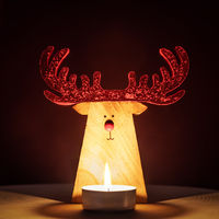 Reindeer Christmas Decoration lit by a candle