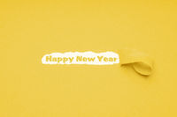 happy new year text on yellow paper background