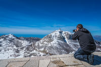 Tourist taking pictures of the Stirovnik peak