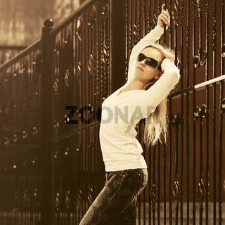 Young fashion blond woman in white pullover and sunglasses