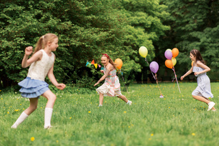 happy girls playing tag game at birthday party