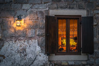 Window and shutters of a local cafe at night
