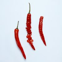 Group of red hot chili pepper on a gray background
