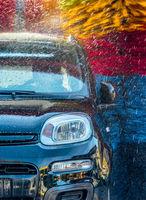 Car going through an automated car wash machine.