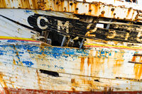 close up view of a broken and cracked hull of an old wooden fishing boat