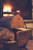 Firewood and burning fireplace at home