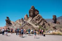 Tourists at Roque Cinchado rock on Mount Teide (Pico delTeide) National Park, Tenerife Spain