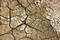 Cracks in Mud From Above. Cracks in mud due to drought. Cracks in the soil of dried out lake