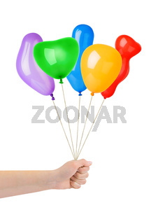 Multicolored balloons in hand