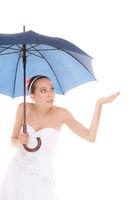 Bride woman hiding taking cover under umbrella