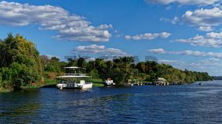 Tourist river cruise boats, Zambezi river, Chobe National Park, Botswana.