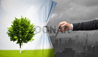hand pulling nature cityscape curtain to gray cityscape