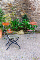 beautiful garden with chairs
