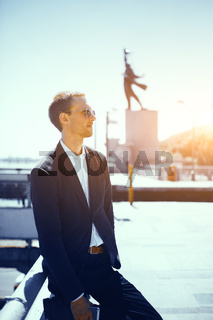 Portrait of handsome businessman outdoors.