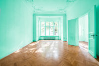 empty room in old apartment building with wooden parquet floor - real estate interior