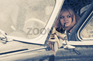 Young fashion couple driving vintage car