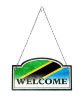 Tanzania welcomes you! Old metal sign isolated