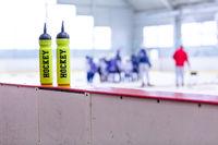 ice hockey rink, bottle on board