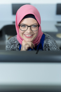 Woman with hijab working in a call center.