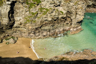 Children playing on beach near Tintagel in Cornwall