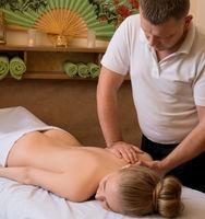 Pretty blonde in spa salon enoying massage