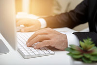 Male businessman typing